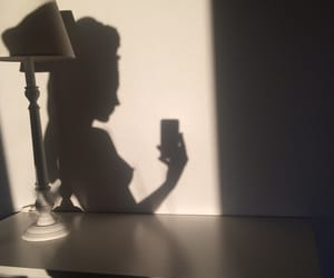 girl, lamp, and shadow image