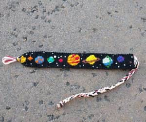 planet, bracelet, and space image