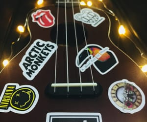 arctic monkeys, coldplay, and guitar image