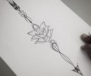 tattoo, arrow, and lotus image