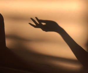 gold, hands, and light image