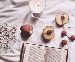 books, fruit, and candle image