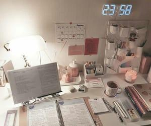 books, clock, and desk image
