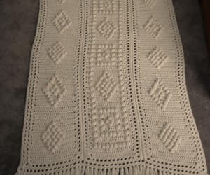 cable knit, celtic, and crochet afghan image