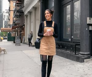 black boots, buns, and fashion image