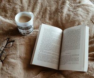book, coffee, and bookshelves image