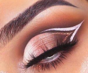 blue eyes, white liner, and orange shadow image