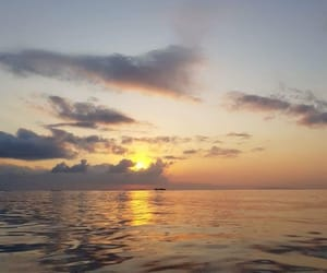 ocean, sunset, and the sea image