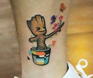 flowerpot, flowers, and Marvel image