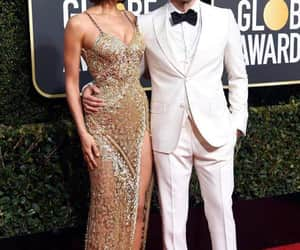 couple, golden globes, and model image