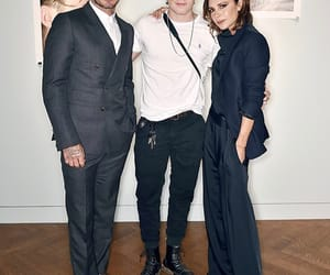 David Beckham, family, and black outfit image