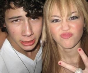 miley cyrus, nick jonas, and old days image
