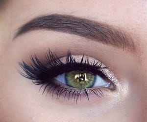 green eyes, lashes, and black liner image