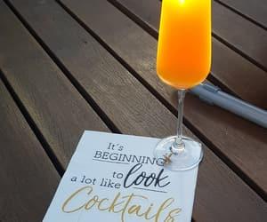 Cocktails, orange juice, and pool image