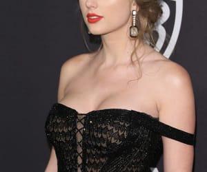 black dress, golden globes, and red lipstick image