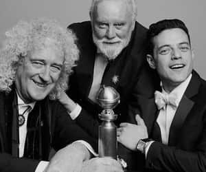 roger taylor, brian may, and rami malek image