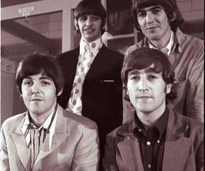 george harrison, john lennon, and Paul McCartney image