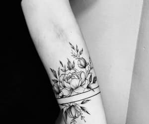 tattoo, flowers, and arm tattoo image