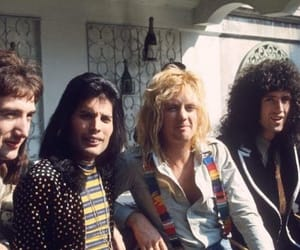 Freddie Mercury, Queen, and brian may image