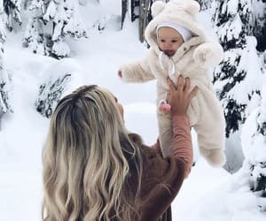 daughter, mother, and snow image