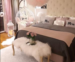 bed, chandelier, and decor image