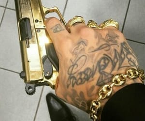 gold, tattoo, and gun image