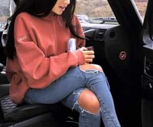 car and ripped jeans image