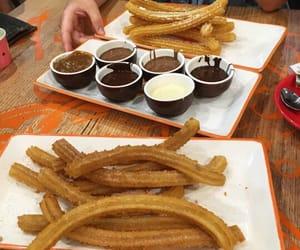 food, churros, and dessert image