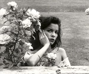 bianca jagger and flowers image