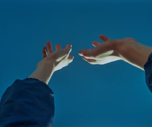 hands, blue, and sky image