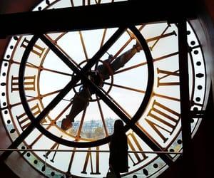 clock, landscape, and hands image
