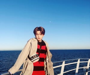 cpop, huang minghao, and nine percent image