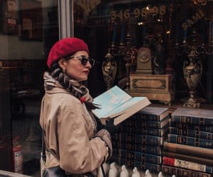 beret, books, and chic image