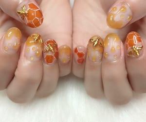 bee, nails, and honey image
