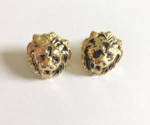 African, etsy, and gold lion image