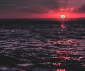 sunset, ocean, and sun image