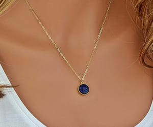 gold necklace, silver necklace, and blue sapphire image