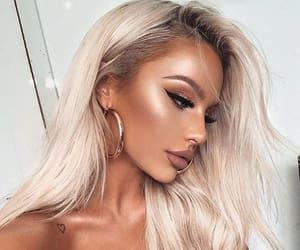 eyebrows, false lashes, and lipgloss image