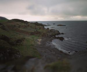 coast, hills, and rocks image