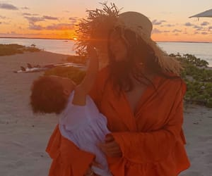 kylie jenner, stormi, and beach image