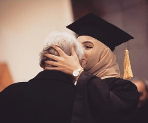 beautiful woman, hijab, and kiss image
