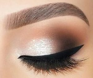 lashes, black liner, and brown shadow image
