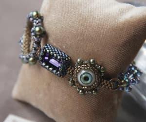 charm bracelet, witchy, and eyeball jewelry image