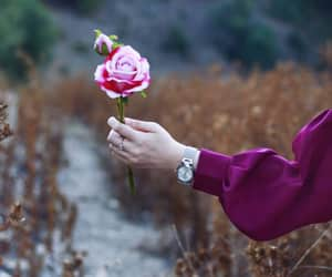 flowers, hand, and hijab image