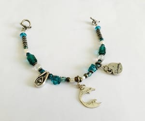 charm bracelet, sparkle, and silver toned image