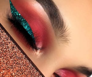 blue eyeshadow, pink, and glitter makeup image