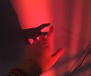 hand, light, and red image