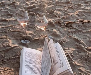book, wine, and beach image