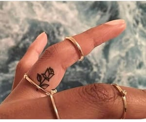 hand tattoo, tattoo, and finger tattoo image