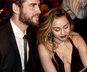 miley cyrus, liam hemsworth, and the last song image
